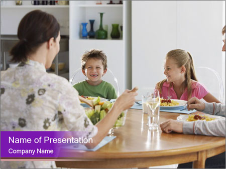 Family eating dinner at round table, in kitchen PowerPoint Templates
