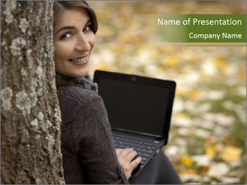 Beautiful woman working with a laptop PowerPoint Template