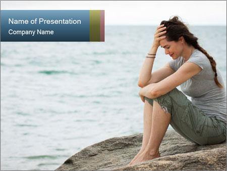 Upset and depressed woman sitting PowerPoint Template
