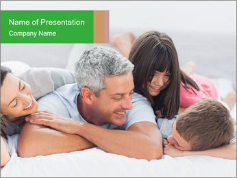 Cute family lying on bed PowerPoint Template - Slide 1