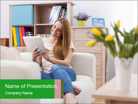 Attractive woman using digital tablet on sofa PowerPoint Templates