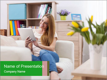 Attractive woman using digital tablet on sofa PowerPoint Template - Slide 1