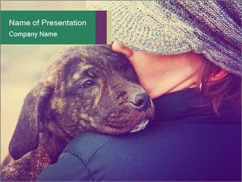 A girl holding a pit bull PowerPoint Template - Slide 1