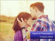 Young man kisses a woman PowerPoint Template