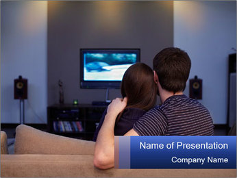 Young couple waching tv PowerPoint Templates - Slide 1