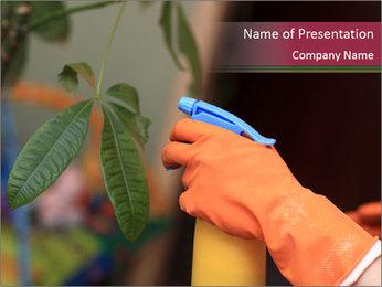 Man Spraying Plants PowerPoint Template