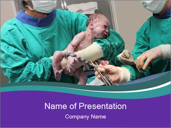A doctor holds a new born baby PowerPoint Template - Slide 1