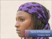 African Woman In Lilac Headgear PowerPoint Template