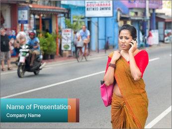 Beautiful woman dressed in sari PowerPoint Template - Slide 1
