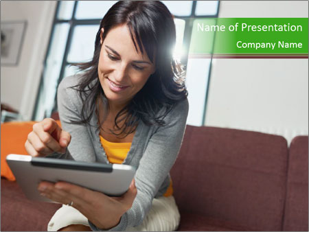 Woman sitting on sofa PowerPoint Template