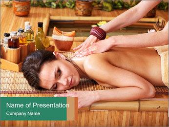 Woman getting massage in spa. Modèles des présentations  PowerPoint