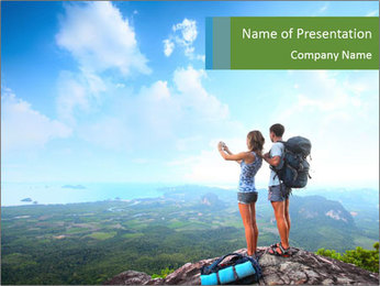 Young tourists from top of a mountain PowerPoint Template - Slide 1