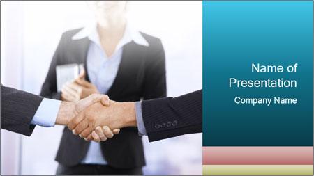Businessmen shaking hands PowerPoint Template
