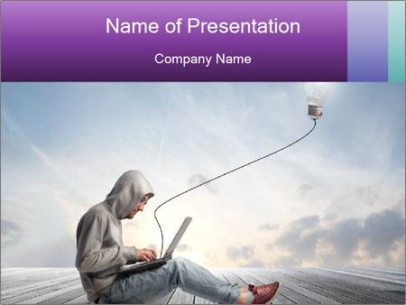 Man using a laptop PowerPoint Template