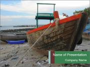 Fishing boat on the beach PowerPoint Templates