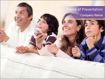 Happy family watching tv PowerPoint Template