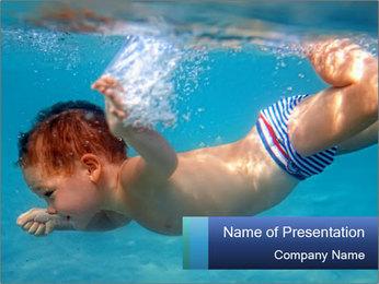 Baby boy dives underwater PowerPoint Template - Slide 1