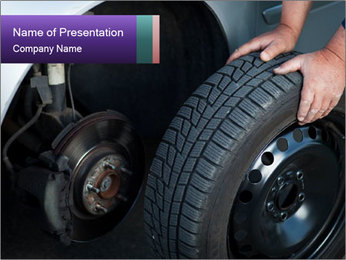Mechanic changing a wheel PowerPoint Templates - Slide 1