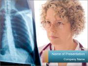 Doctor looking xray PowerPoint Templates