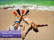 Bride and Groom lying on beach PowerPoint Templates