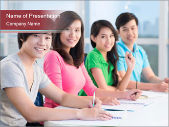 Four students sitting in classroom PowerPoint Template - Slide 1