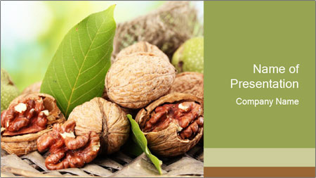 Walnuts with green leaves PowerPoint Template
