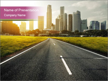Asphalt road leading to a city PowerPoint Templates - Slide 1