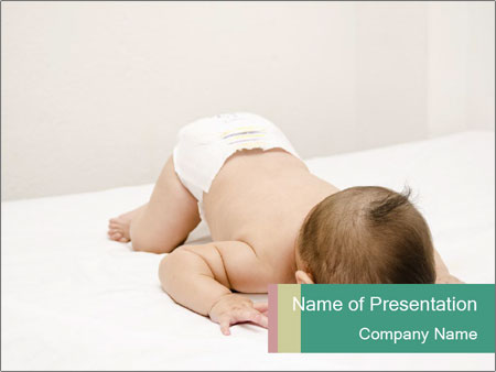 Baby on bed PowerPoint Templates