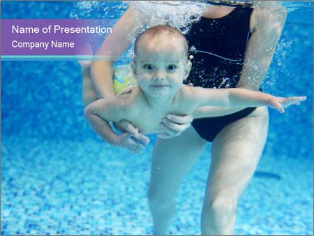 Little boy learning to swim PowerPoint Template