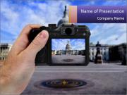 Hand holding camera PowerPoint Template