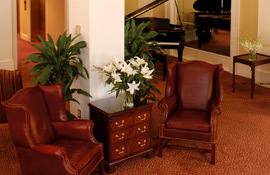 Planters Inn armchairs and piano
