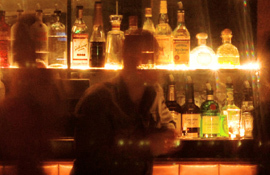 Sunset Marquis backlit bottles at the bar
