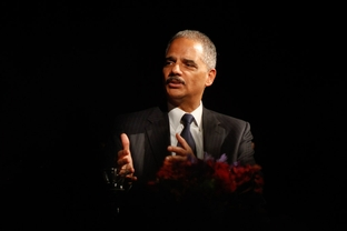 U.S. Attorney General Eric Holder speaking at the University of Texas LBJ Presidential Library on Dec. 13, 2011.