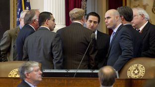 House members huddle at dais on February 14th, 2013