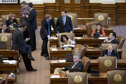 Texas House members conduct business during the extended debate on HB 2 July 9, 2013.