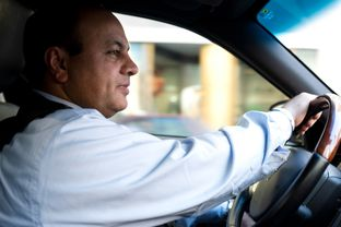 Sunny Singh, a driver for Uber, navigates the streets of Dallas, Texas on October 22, 2013. Uber, an upscale car and driver company that has been welcomed in many major metropolitan areas, has faced a tougher-than-usual road in Texas, especially Dallas, where they continue to battle political and legal obstacles.