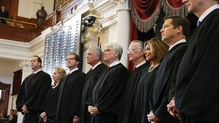 The Texas Supreme Court convenes in the House chamber for a special ceremony on November 11, 2013.