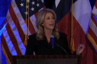 State Sen. Wendy Davis, D-Fort Worth, a Democratic candidate for Governor, speaking at the Travis County Democratic Fundraiser on Jan. 28, 2014.