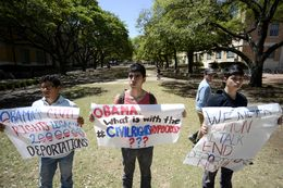 From left, immigration rights activists Manuel Ramirez, Lucian Villasenor and Adrian Orozco protest President Obama's Civil Rights Summit speech at the University of Texas in 2014, challenging the president's dedication to civil rights.
