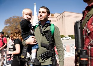 Chris Way and his son Ryan, 2, participate in a march during South by Southwest in March 2014, an event led by the Austin chapter of the gun rights group Come and Take It.