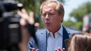 Candidate for Lieutenant Governor David Dewhurst addresses the media in the parking lot of an Austin HEB before voting early in the 2014 runoffs, May 19, 2014.