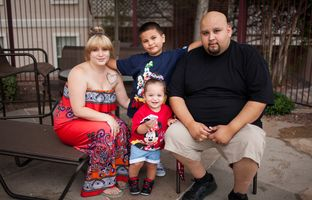 Juan Carlos Pacheco with wife Jessica, son Victor and daughter Xochitl outside their apartment on Sunday in El Paso. Pacheco rents a room in Odessa, where he works for Child Protective Services, and travels regularly to El Paso to visit his family.