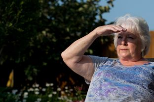 Debbie Ingram poses for a photograph in her backyard on July 22, 2014 in Argyle, Texas. Just a few hundred feet over the hill is a gas well that was last fracked in March.
