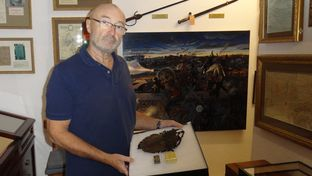 Phil Collins with his collection of Alamo artifacts at his home in Switzerland.