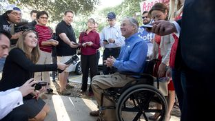 Governor candidate Greg Abbott holds a short press conference after voting in south Austin on Oct. 30, 2014.