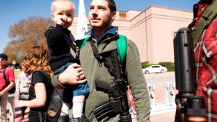 Chris Way and his son Ryan, 2, participate in an open carry march on March 12, 2014 during the South by Southwest festival. The event was led by the Austin chapter of Come and Take It.