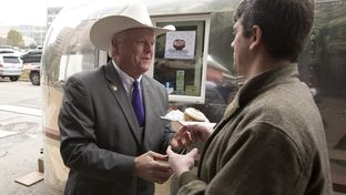 Texas Agriculture Commissioner Sid Miller gives away cupcakes at a press conference on Jan. 12, 2015.