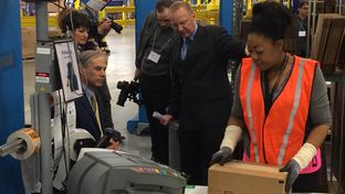 Gov. Greg Abbott tours Amazon's new distribution center Friday outside San Antonio. The hub in Schertz is one of three in Texas.
