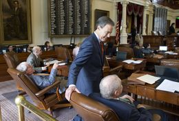 House Speaker Joe Straus, R-San Antonio, takes a break from the chair to speak with members during floor debate on May 27, 2015.