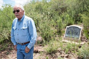 Tom Beard stands near the historical marker for the natural spring on his Brewster County ranch. He fears Energy Transfer Partners will use eminent domain to build its pipeline through his land.